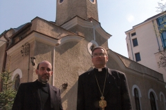 Bishop Christo Proykov (right) standing with Father Blagovast, standing in front of the Assumption church, Sofia. They are Byzantine Catholics. Bulgaria.